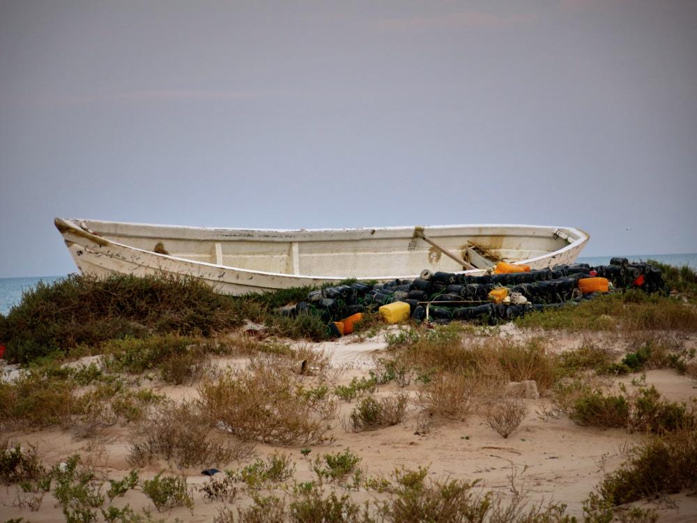 Fischerboot und Netz